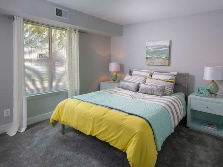 New Castle DE apartment bedroom decorated in beachy yellow and green