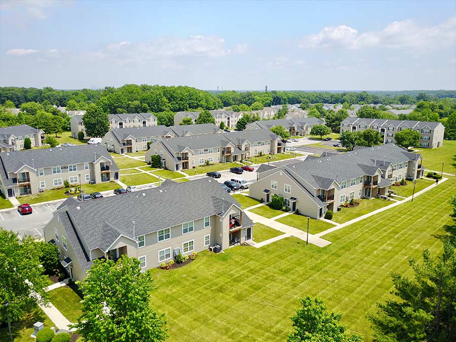 Several apartment homes and ample parking spaces photographed from above at Sophias Place East in New Castle DE