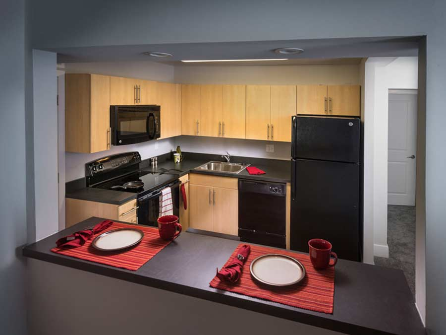 kitchen with breakfast bar in a New Castle DE apartment building