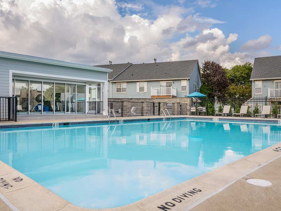 the large outdoor swimming pool is one of the many apartment amenities at Sophias Place East in New Castle DE