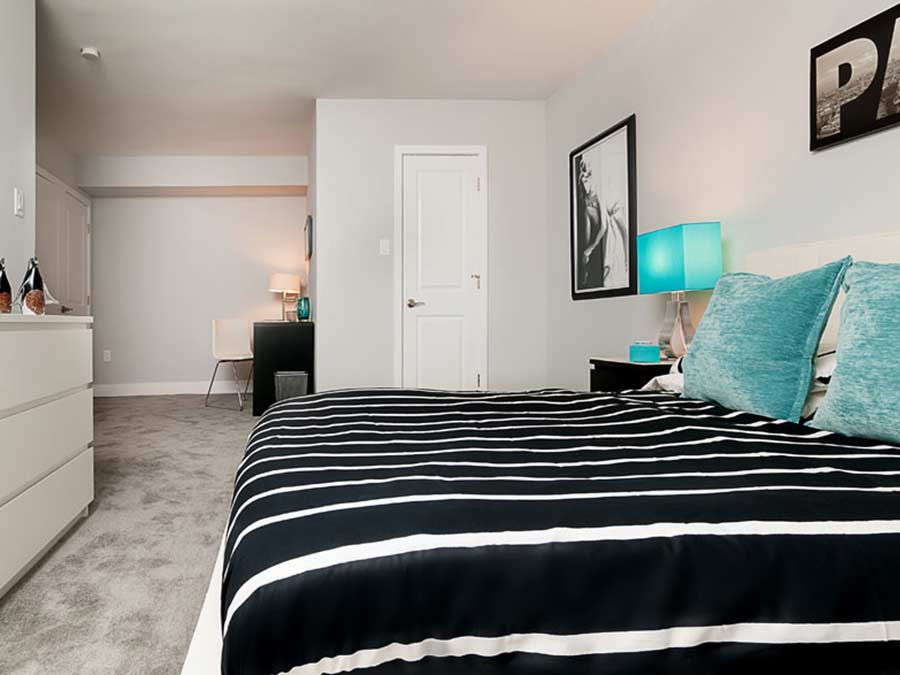 fully furnished bedroom is decorated for corporate housing options in New Castle DE