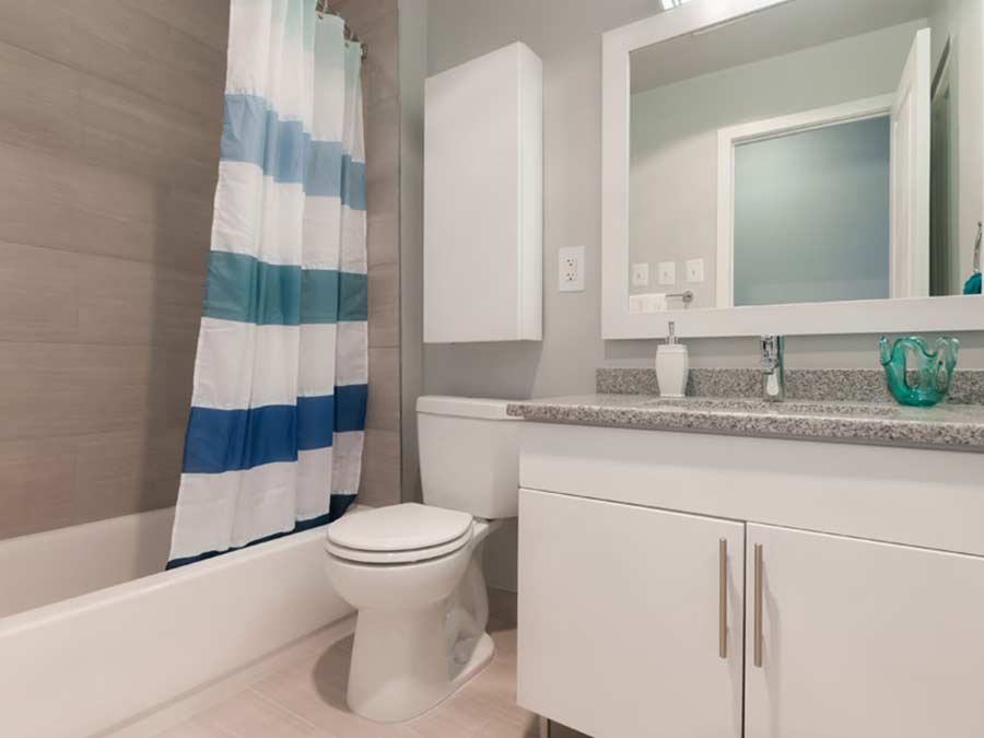 Spruce Court Apartments bathroom with tiled shower