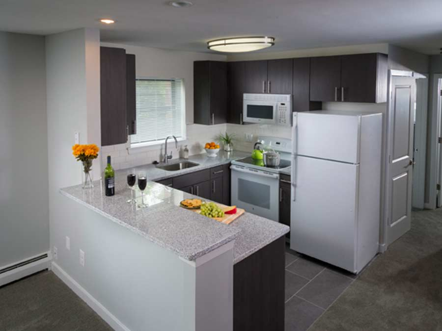 Spruce Court Apartments kitchen with breakfast bar