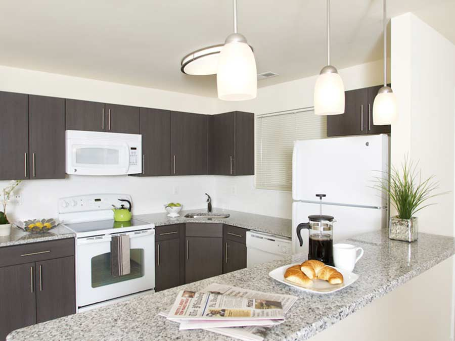 Spruce Court Apartments updated kitchens with white appliances
