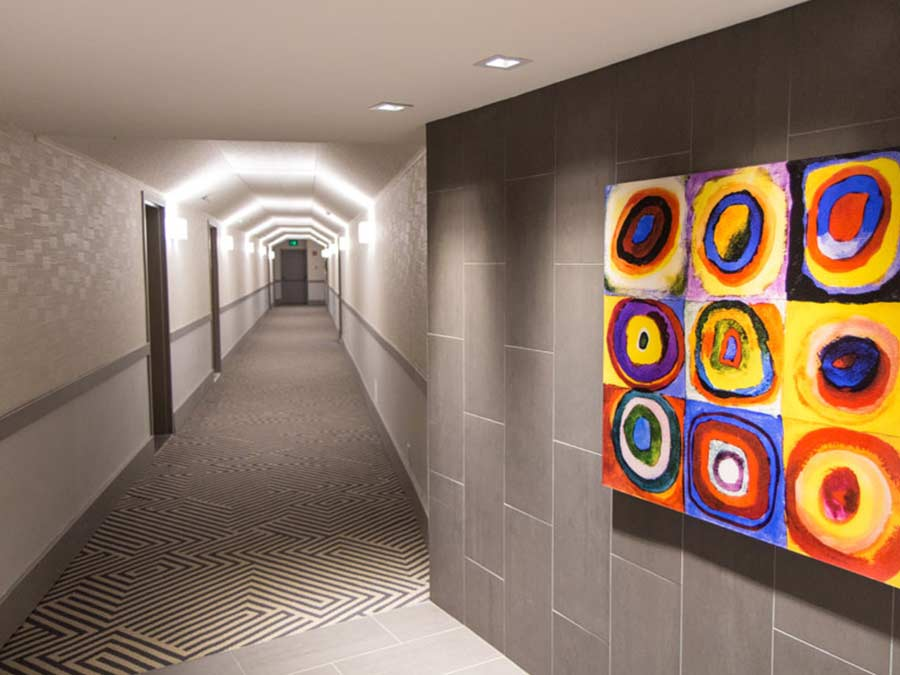 Valley Forge Towers interior hallway with bright painting on the wall