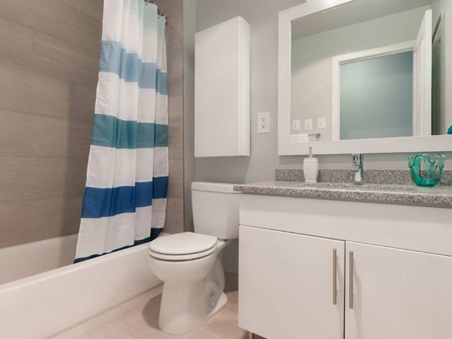 new bathrooms design with neutral white cabinets at the Whitney Apartments in Claymont DE