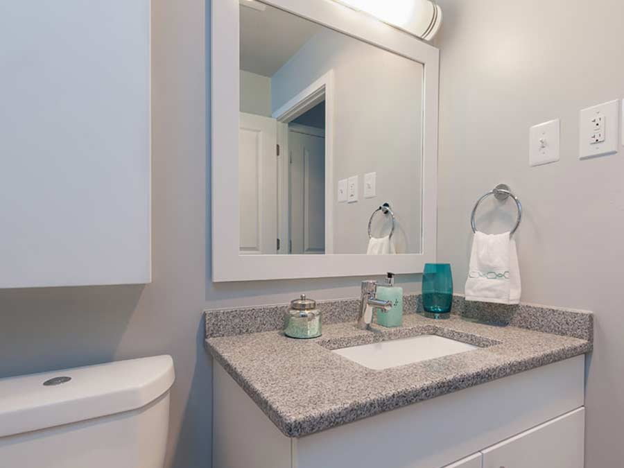 bright and clean vanity in the Whitney Apartments bathroom in Claymont DE