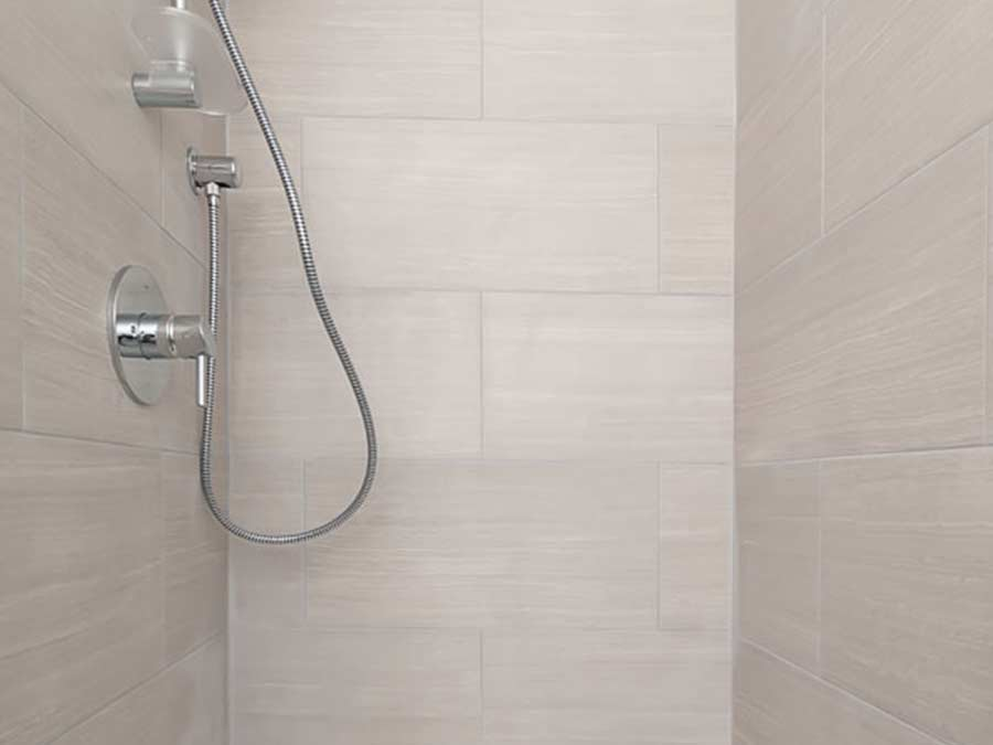 new showers and tile in Claymont DE apartment at the Whitney Apartments